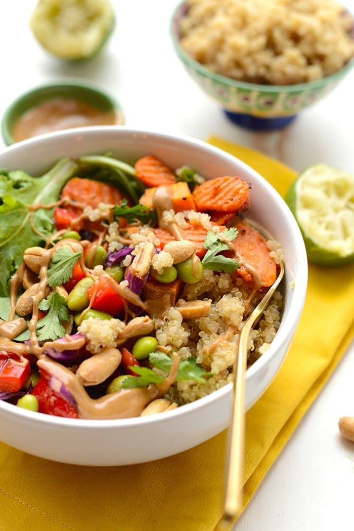Thai coconut quinoa bowl with peanut dressing served in a bowl