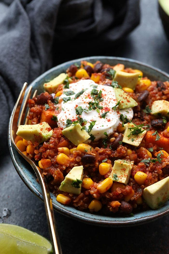 Slow cooker sweet potato Mexican quinoa in a bowl served with avocado and greek yogurt