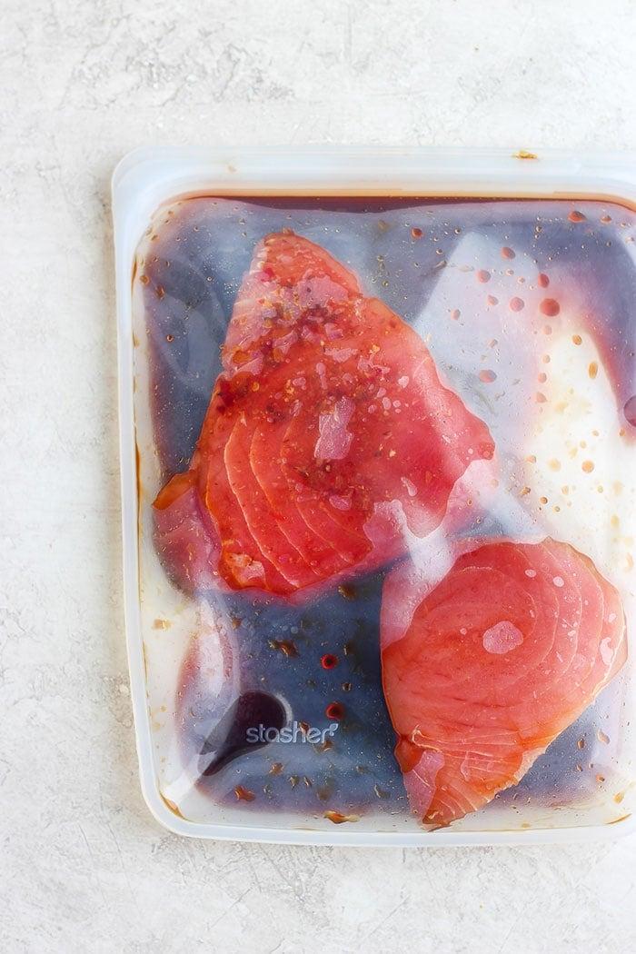 ahi tuna steak being marinaded