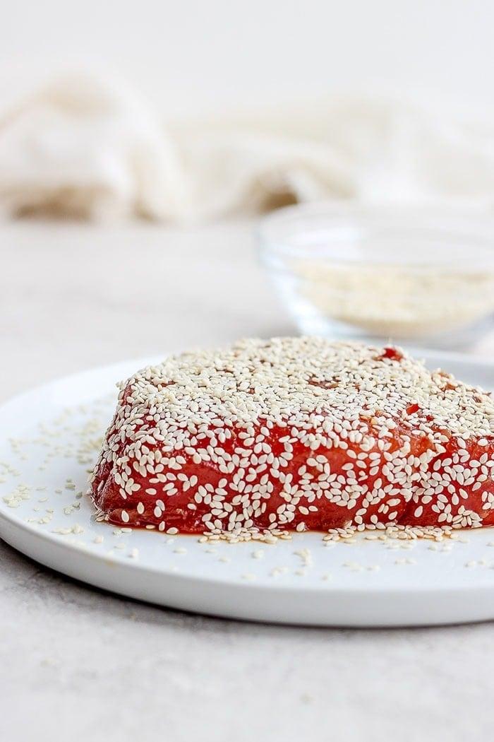 ahi tuna covered in sesame seeds on a plate