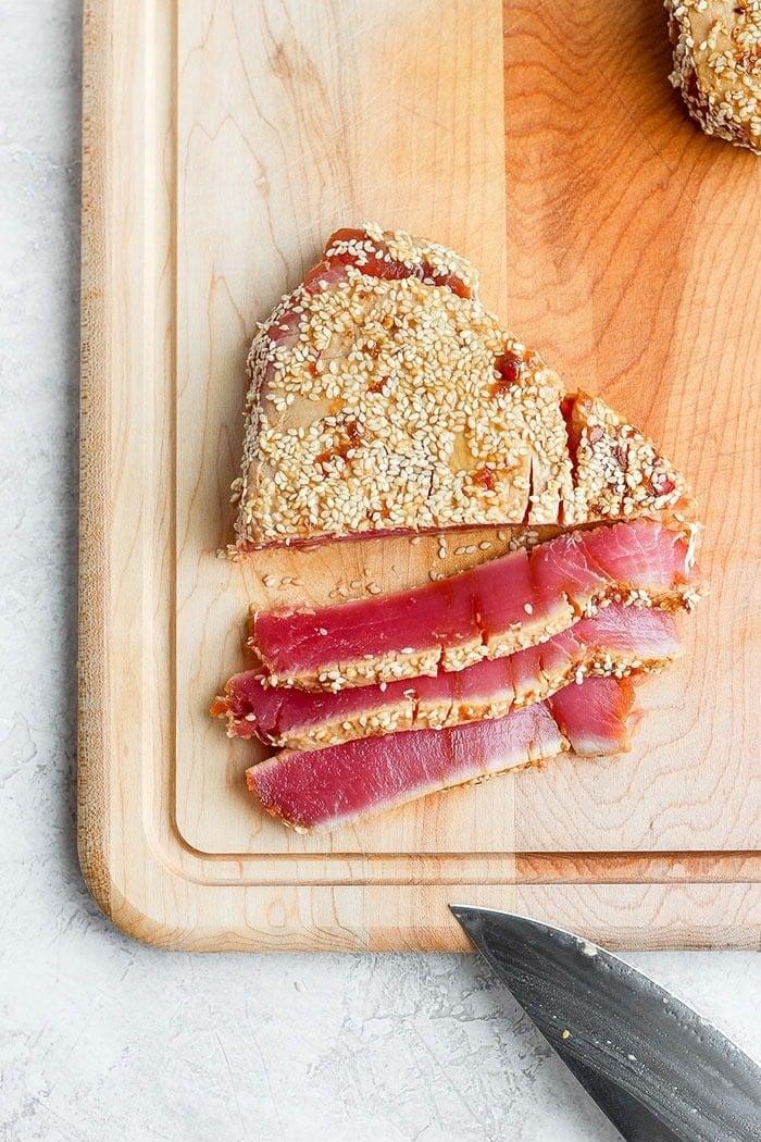 seared ahi tuna steak on a cutting board