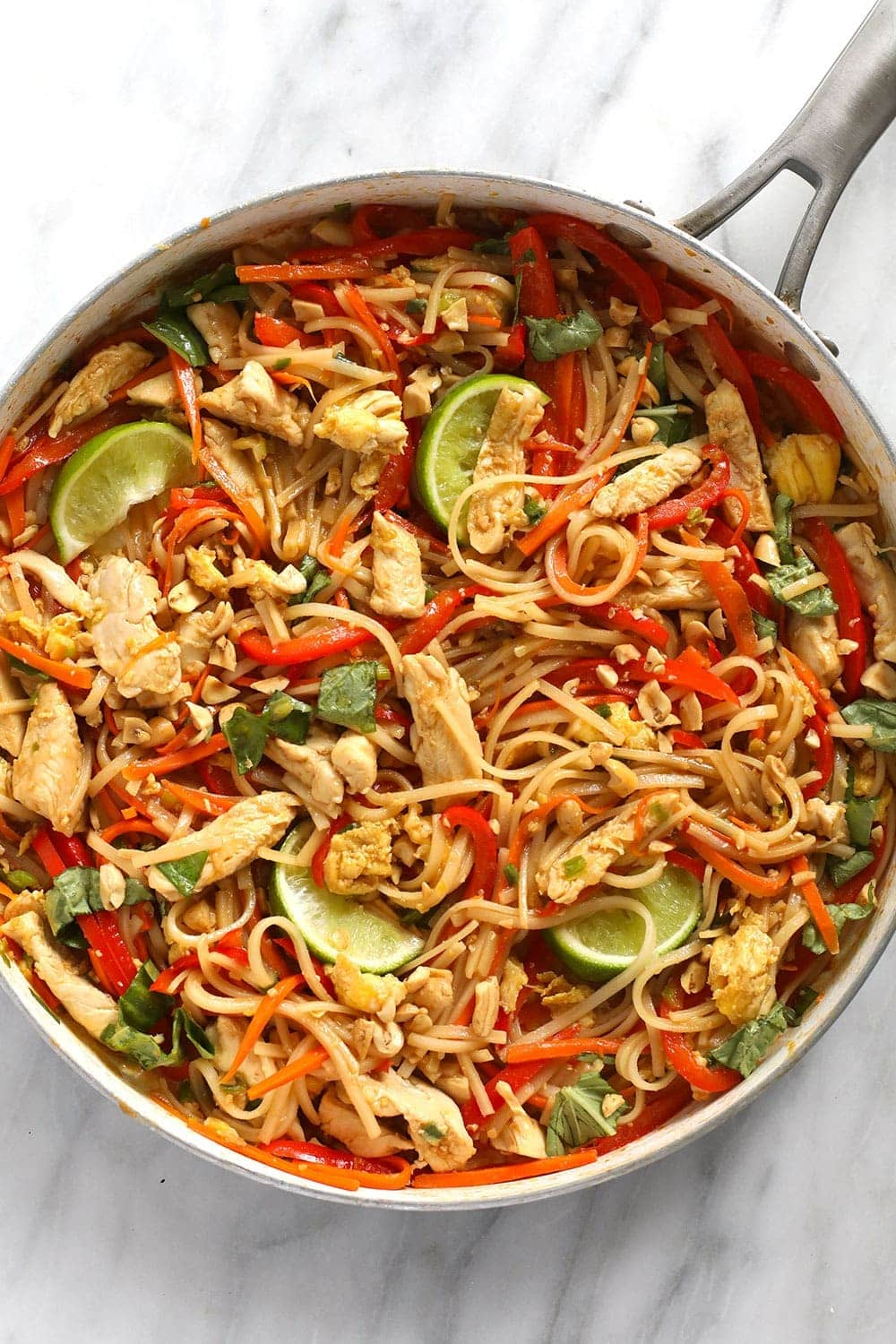 Chicken pad Thai mixed together and ready to eat in a pan.