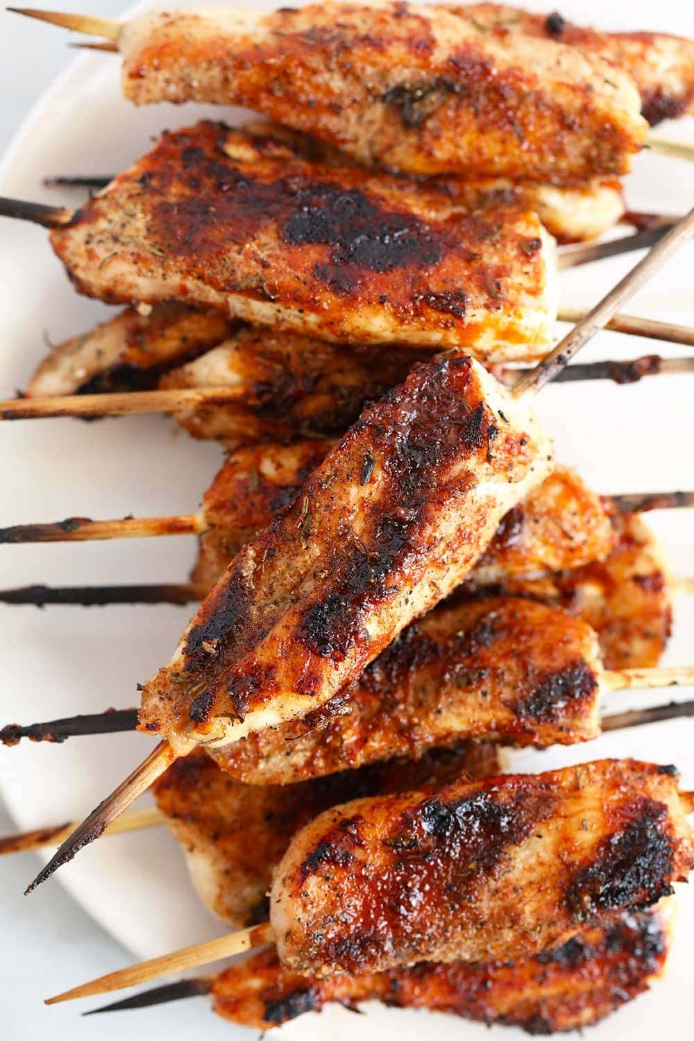 Grilled chicken skewers on a plate