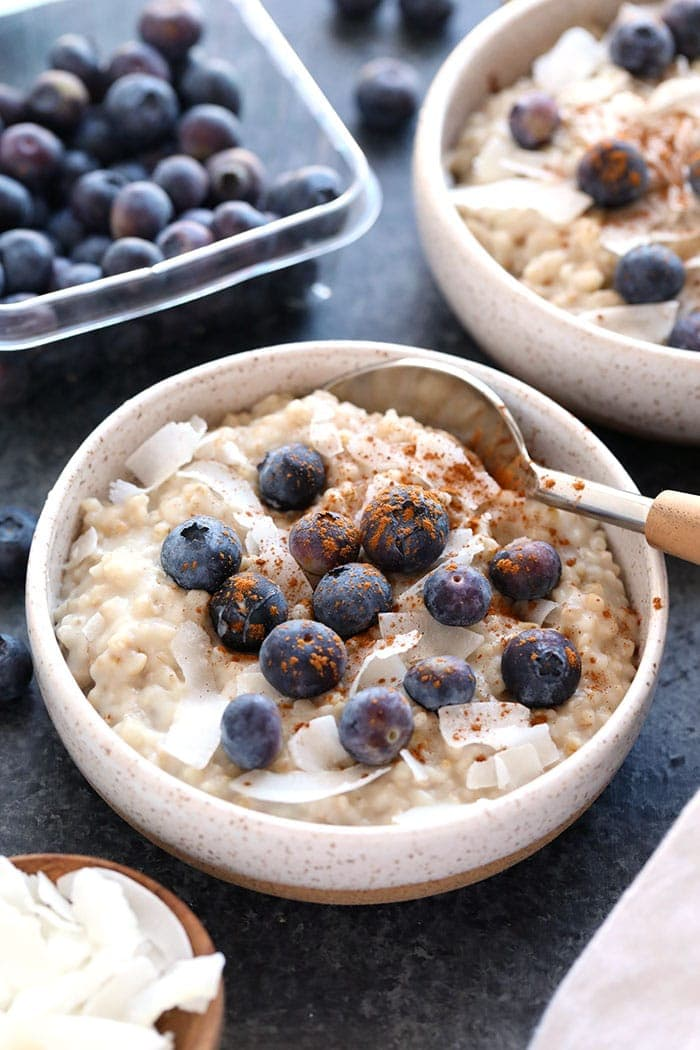 creamy coconut slow cooker steel cut oats in a bowl with a spoon