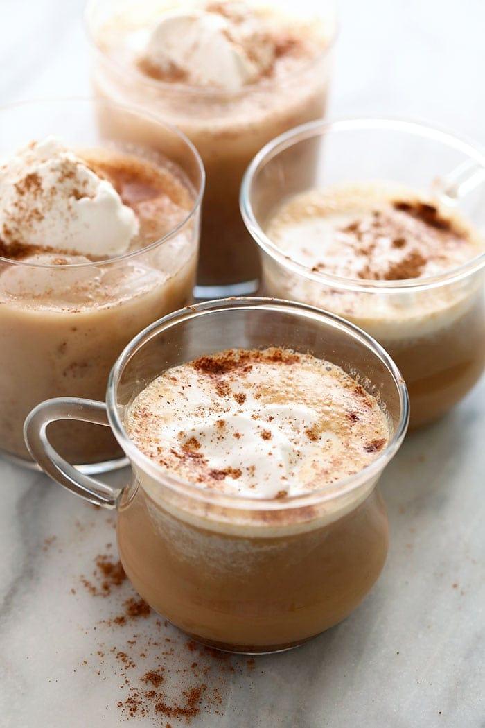 chai tea latte in a glass mug
