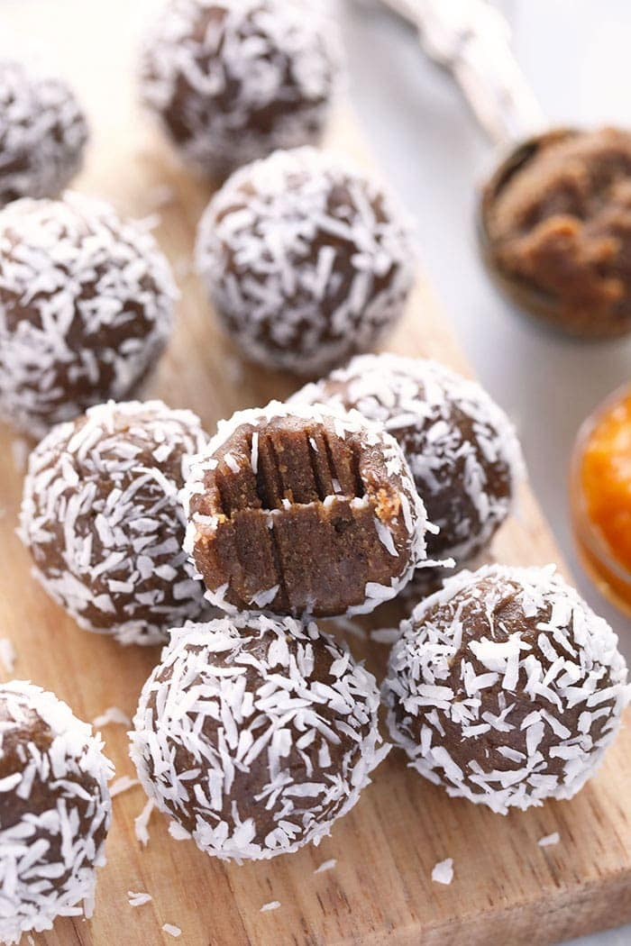 Energy balls stacked on a cutting board