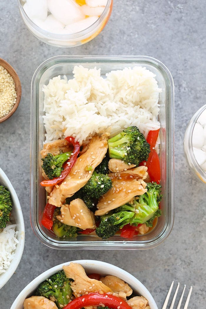 Chicken and broccoli stir fry in a meal prep container.