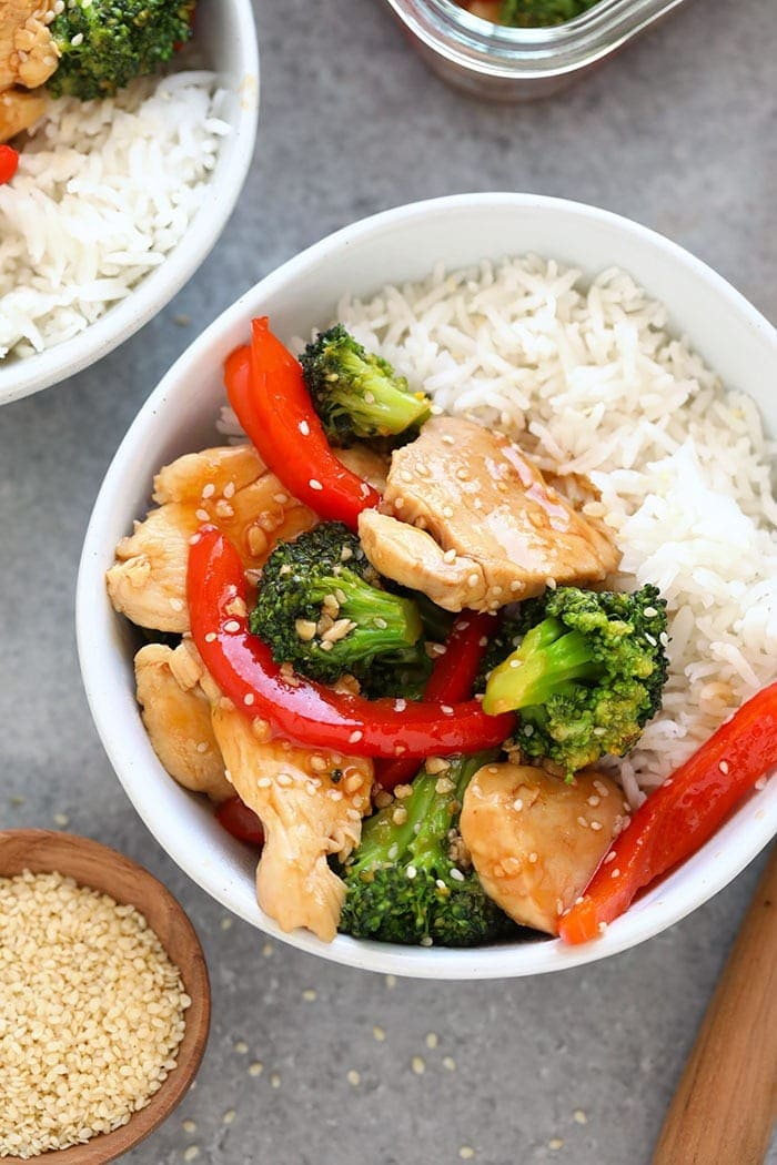 Chicken and broccoli stir fry in a bowl.