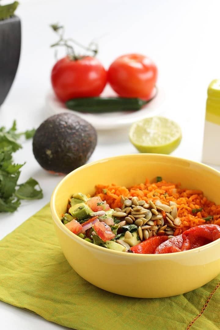 Jalapeño Carrot Rice Salad with Avocado, Roasted Pepitas & Charred Red Peppers