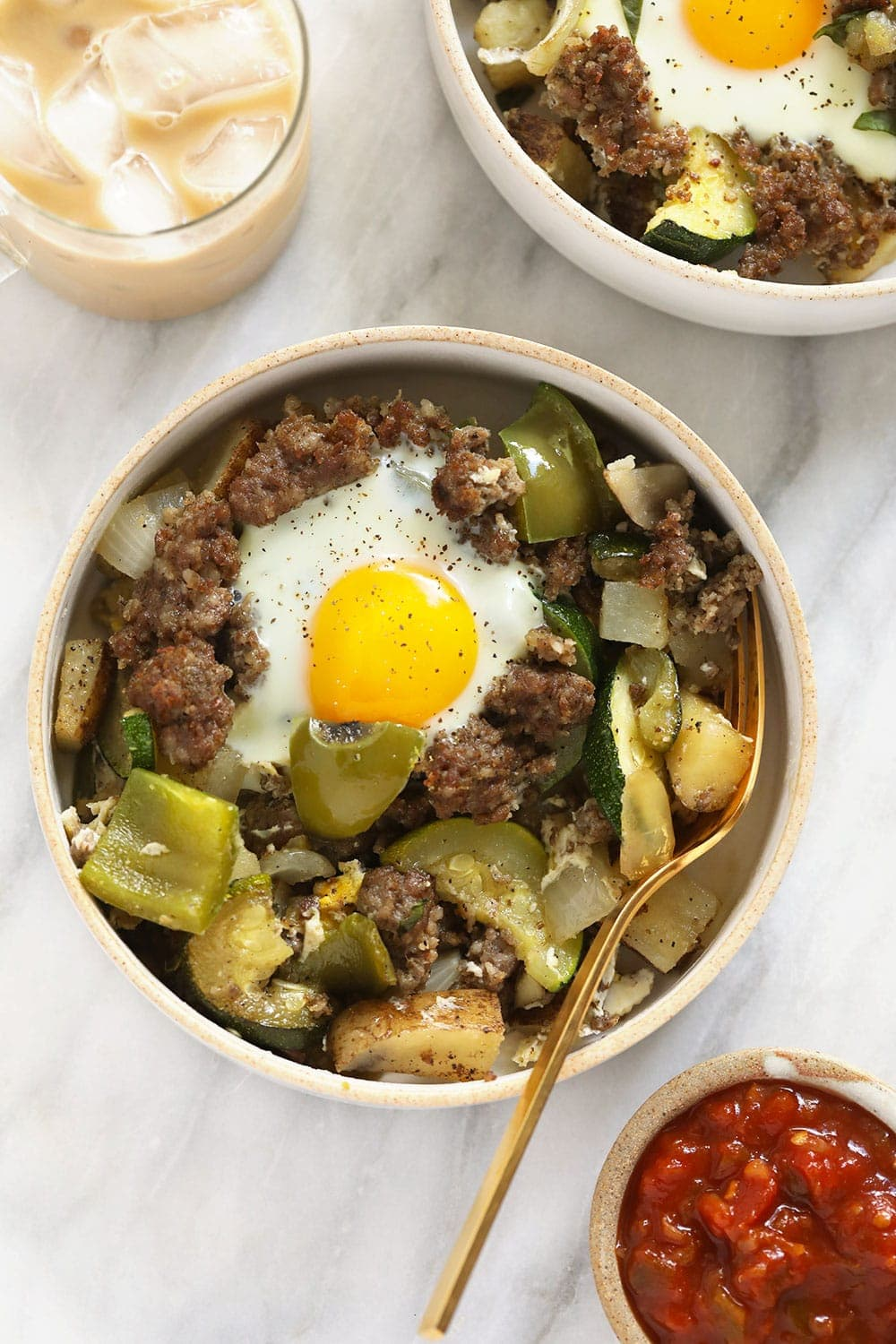 garden breakfast hash in a bowl topped with an egg