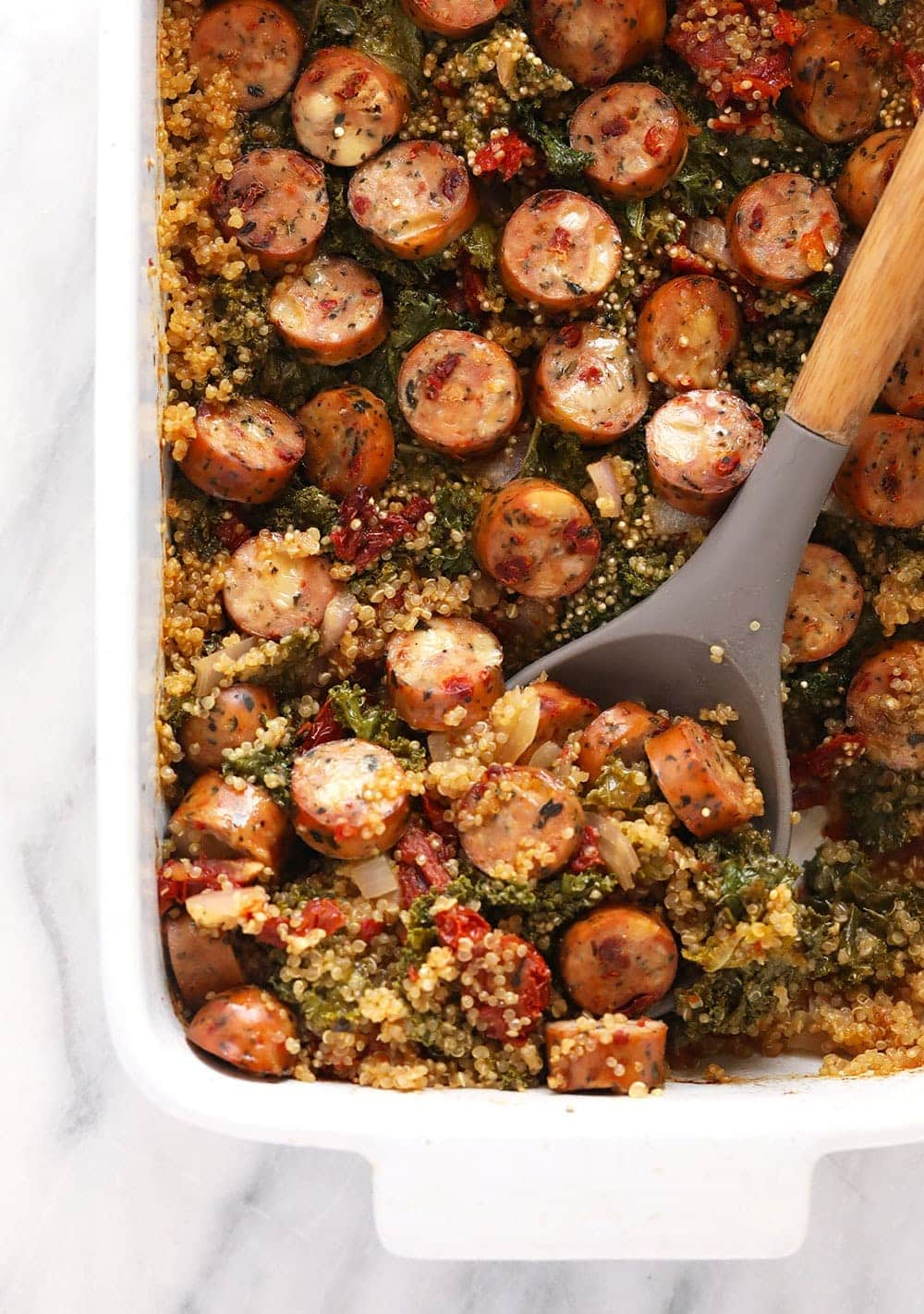 quinoa casserole with large serving spoon