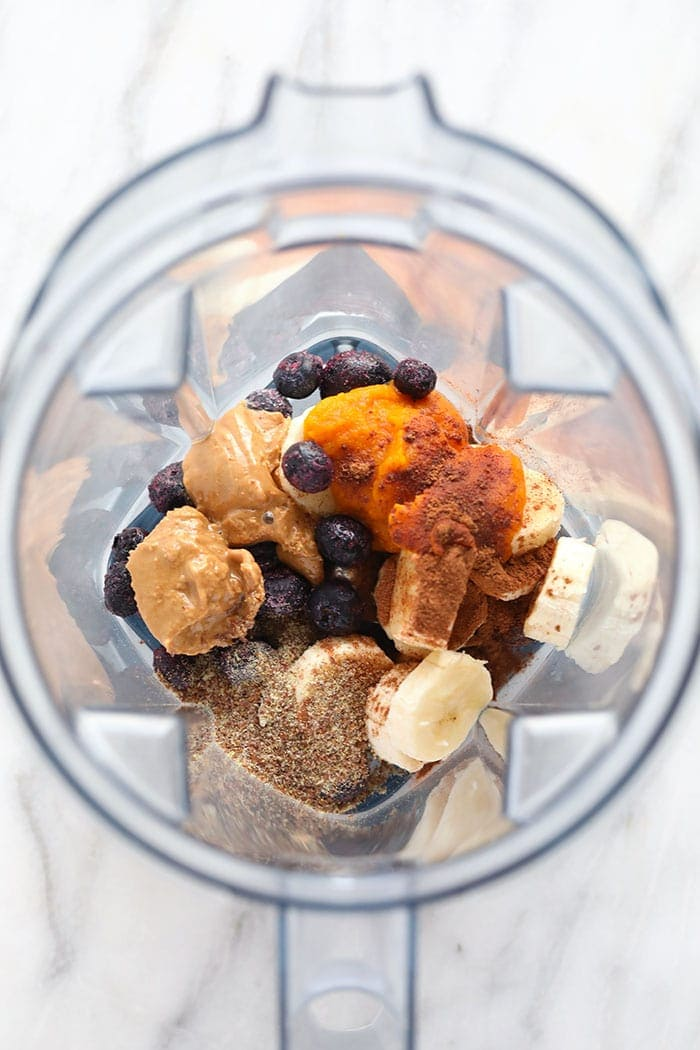Pumpkin berry smoothie ingredients in a blender