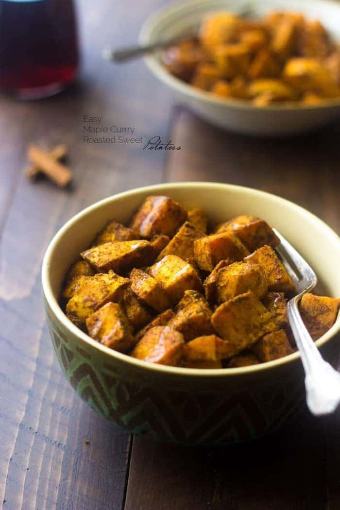 Roasted sweet potatoes served in a bowl with a fork.