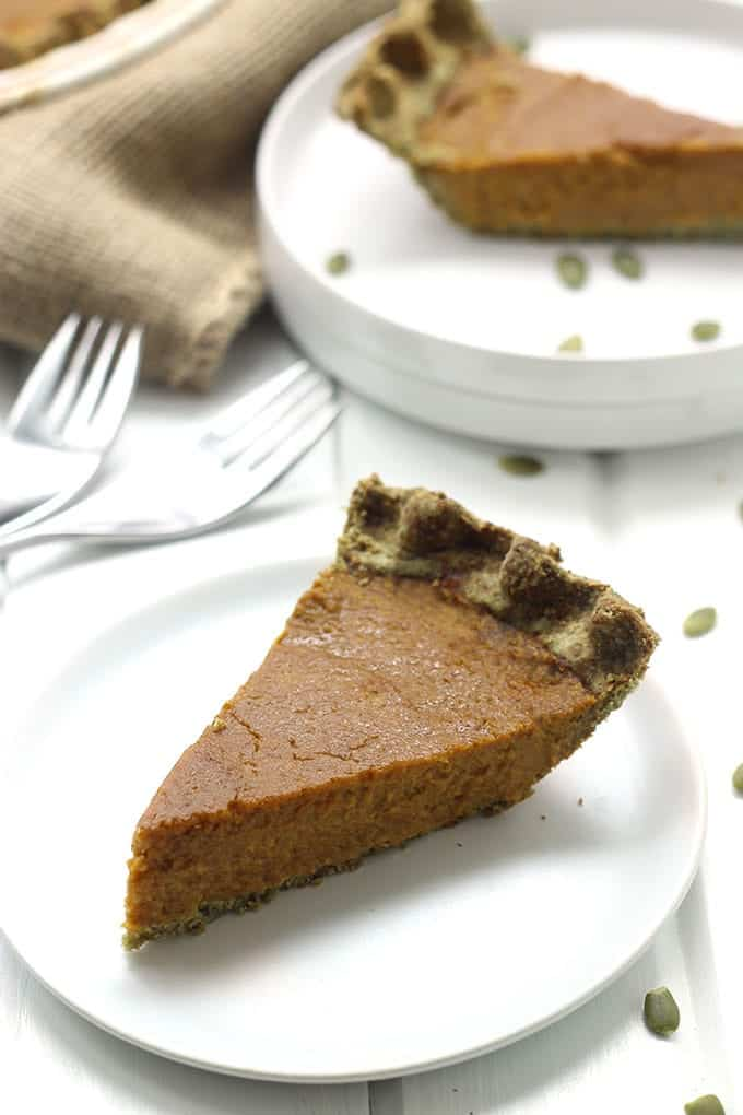 A slice of paleo pumpkin pie served on a plate.