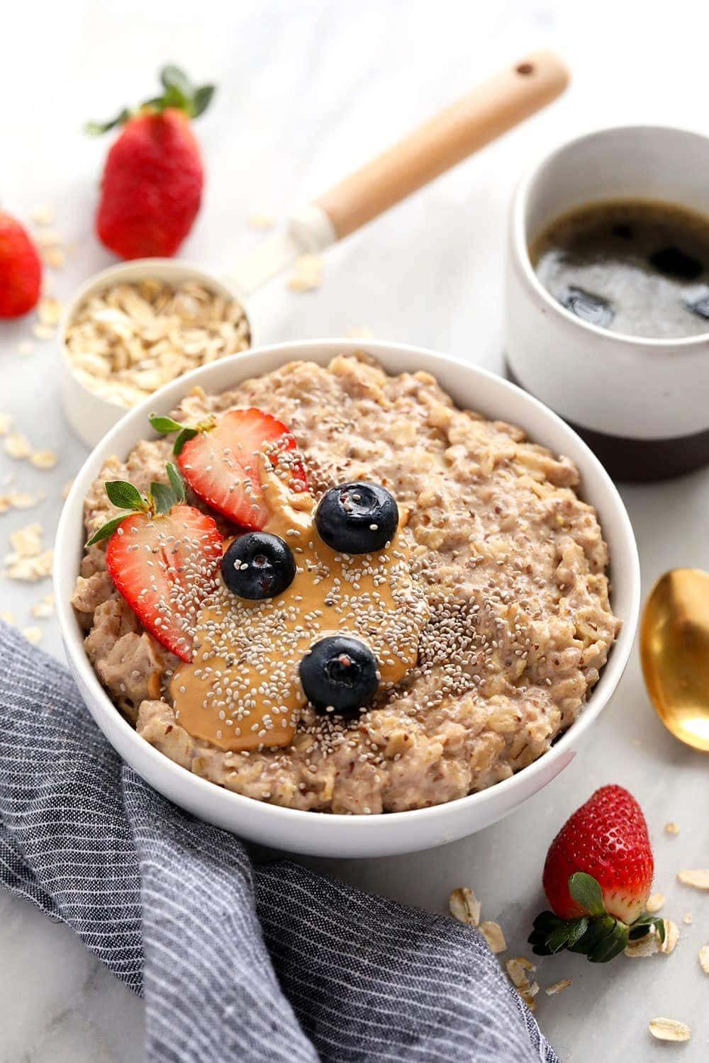 superfood oatmeal bowl topped with berries and nut butter