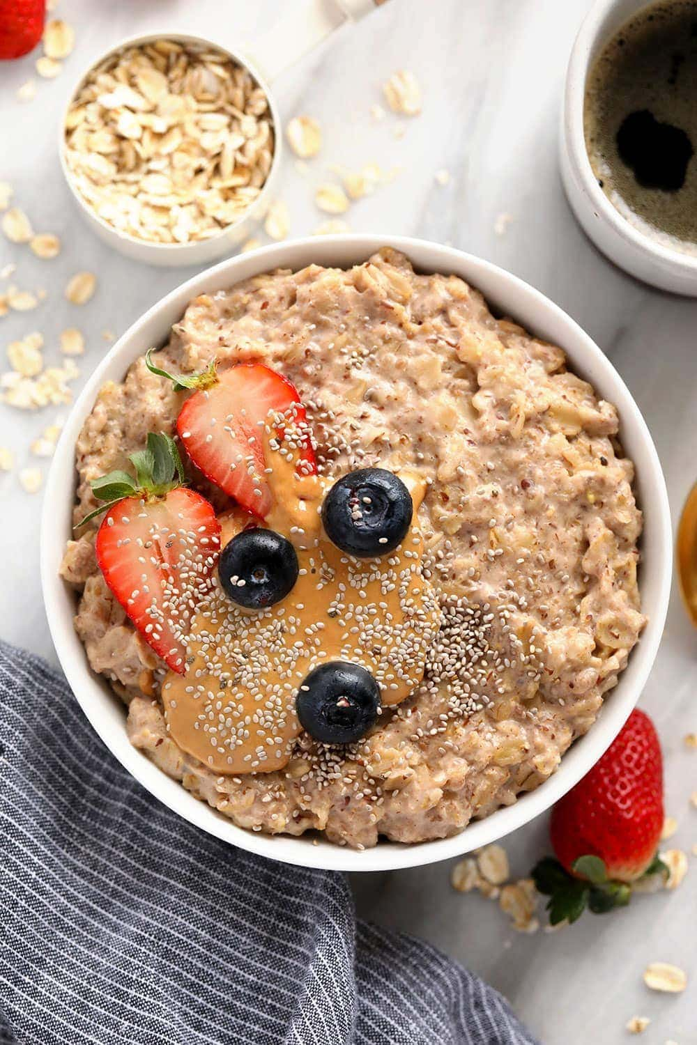 superfood oatmeal bowl topped with berries and chia seeds