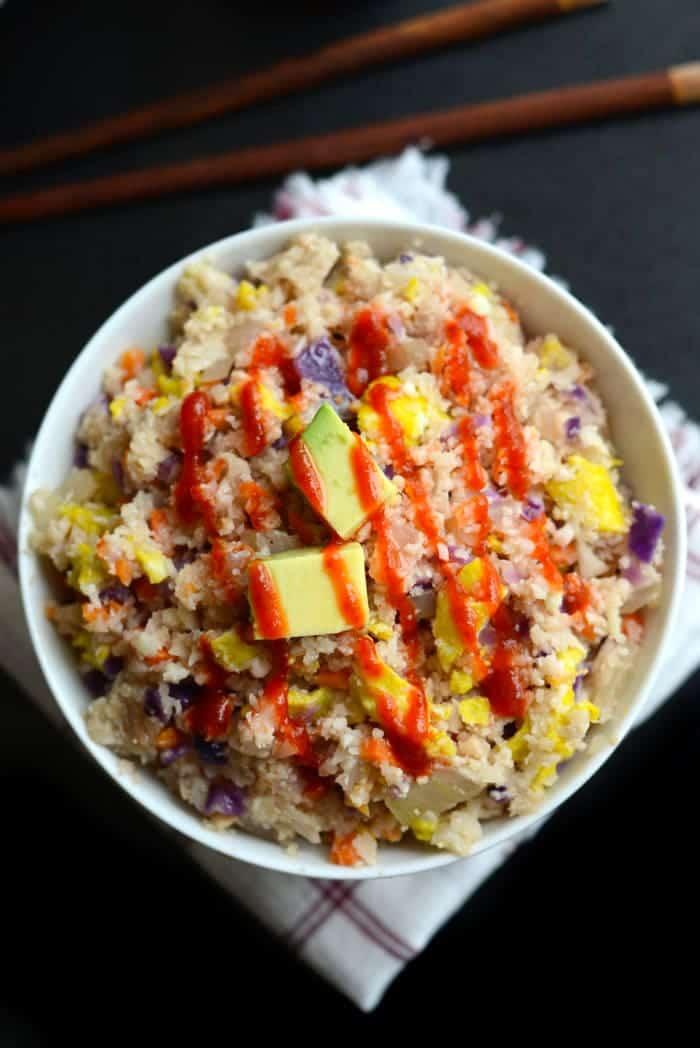 Make this Paleo Fried Rice using cauliflower in place of rice and tons of veggies for a healthy, quick, 30-minute meal that's vegetarian and delicious.
