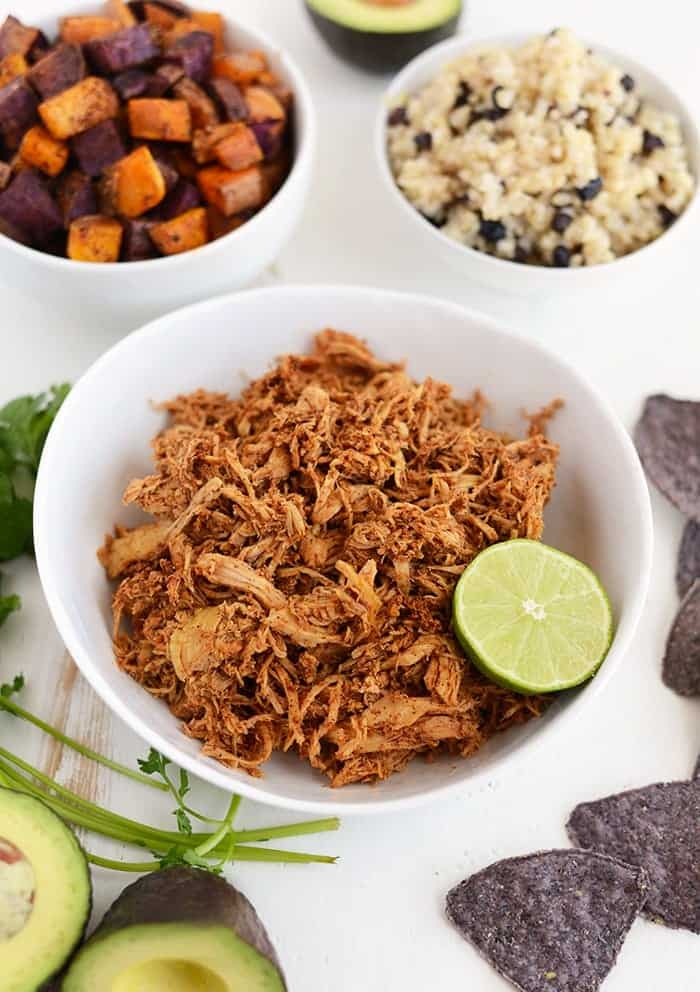 prepared ingredients for crock pot chicken taco bowls on white table