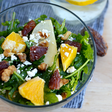 Whip together a delicious citrus vinaigrette and make this Spring citrus kale salad made with dates, feta, apple, and walnuts!