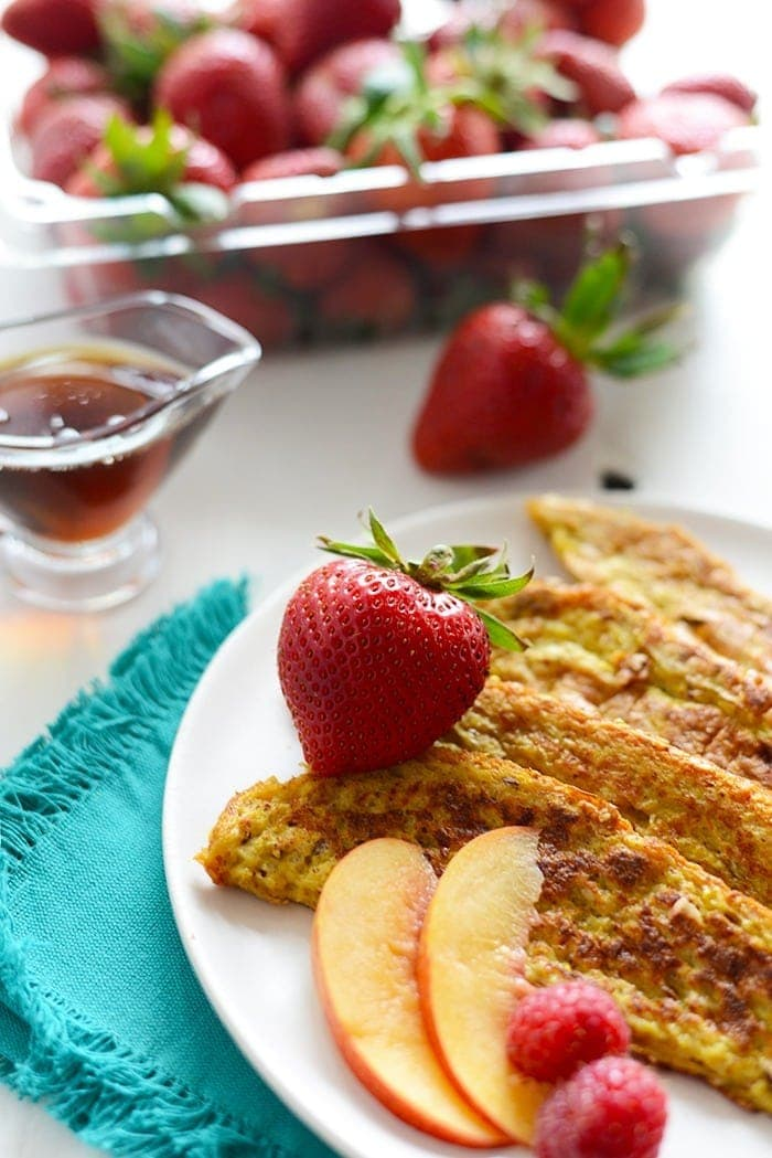 french toast sticks on a plate with fruit