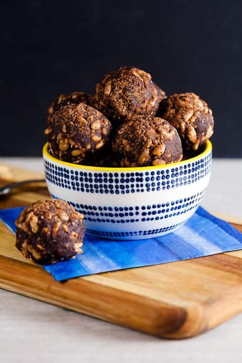Two-bite crispy chocolate peanut butter energy balls are just what you need when you're looking for an afternoon pick-me-up. Dates add a touch of natural sweetness and peanut butter, chia, and flax add plenty of filling protein.