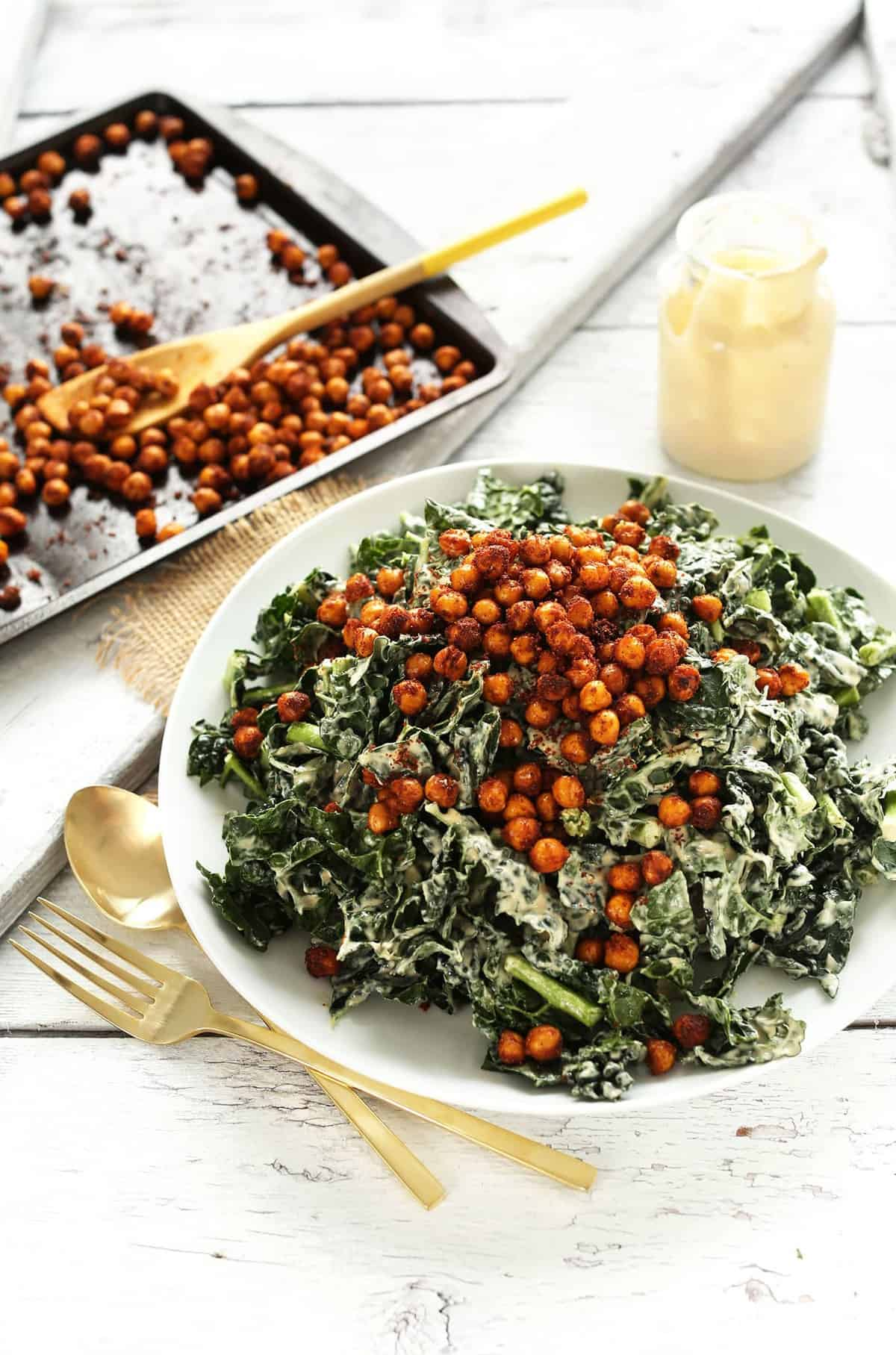 SUPER flavorful, 30-minute Kale Salad with a creamy roasted garlic tahini dressing and crispy tandoori roasted chickpeas!