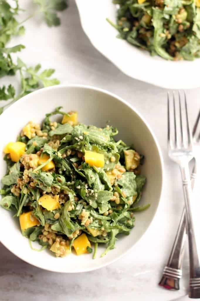 This spring salad has the perfect balance of chewy wheat berries, spicy arugula, sweet mango, and creamy cilantro lime dressing.