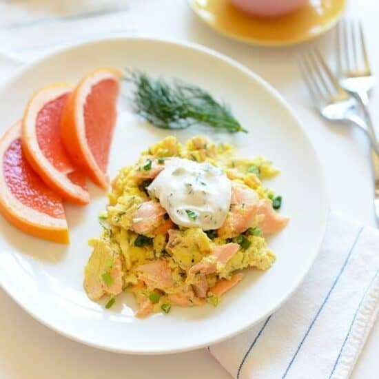 salmon and scrambled eggs with side of grapefruit slices