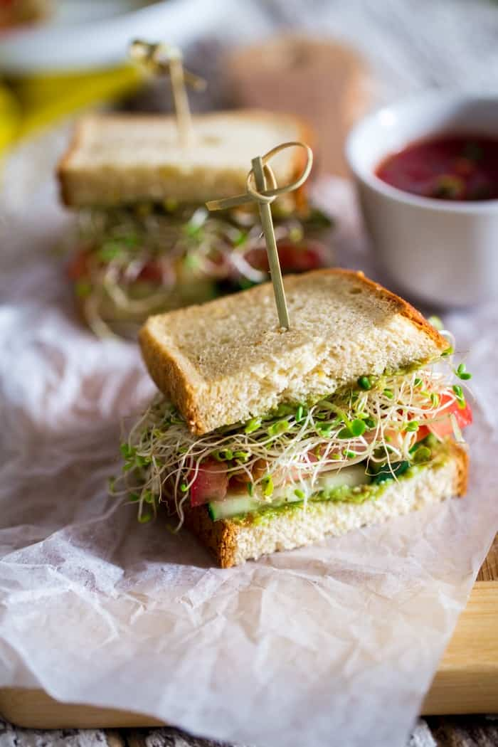 These gluten free sandwiches are layered with a creamy Mexican avocado spread, spicy sprouts, fresh tomatoes and crunchy cucumber slices. They're an easy, healthy meatless lunch option for work or school lunch boxes!