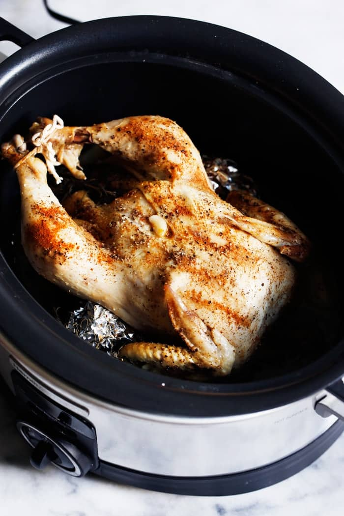 Dinner has never been so good! Packed with delicious flavors, this slow-cooked roasted whole chicken is so easy to throw together, and makes for the perfect meal! Pair it with veggies, salad, or anything you'd like and you are ready to go!