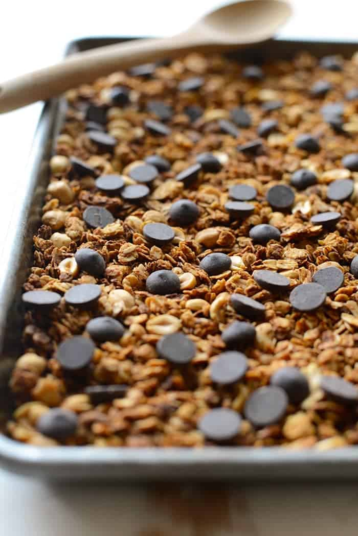 peanut butter cup granola on a cookie sheet
