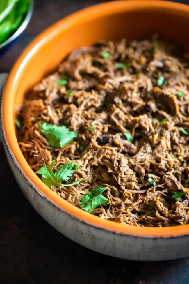 This tender, paleo, slow cooker roast beef is mixed with pumpkin and salsa and then shredded! It's perfect in tacos or on a salad for a healthy, weeknight meal that is full of fall flavor!