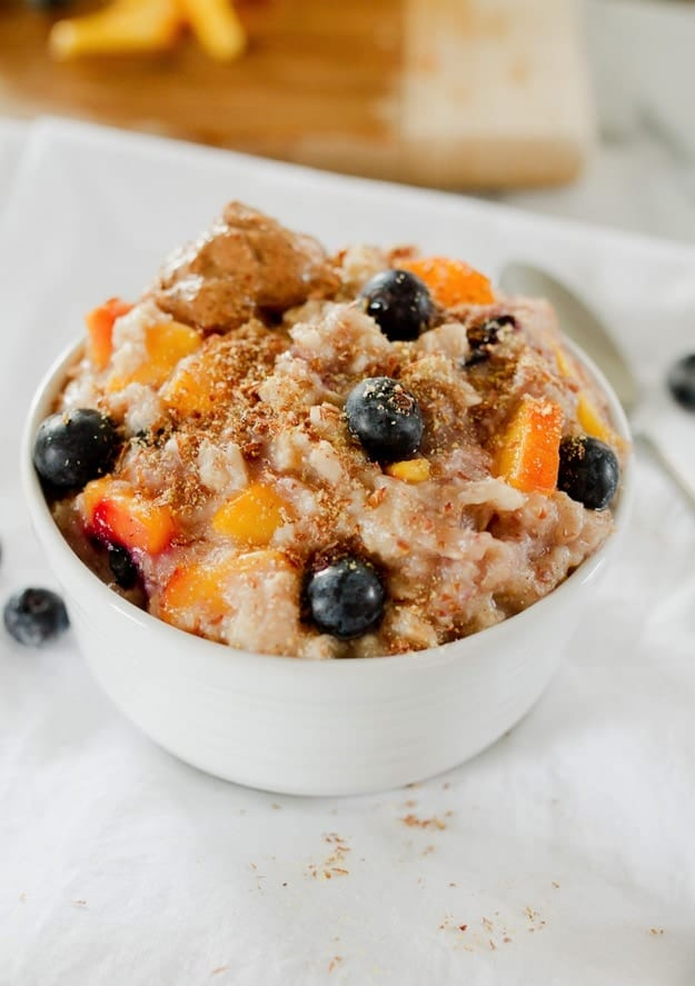 Add fresh peaches and blueberries to your oats for a healthy and flavorful bowl of blueberry peach oatmeal. Loaded with fiber, healthy fat and protein this delicious bowl of oats will keep you feeling full and energized all morning.