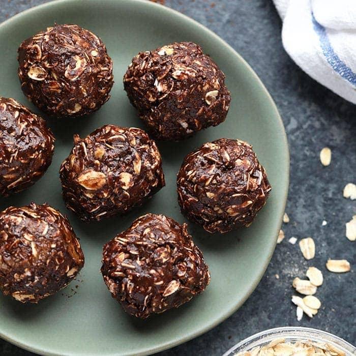 chocolate no bake peanut butter balls on a plate