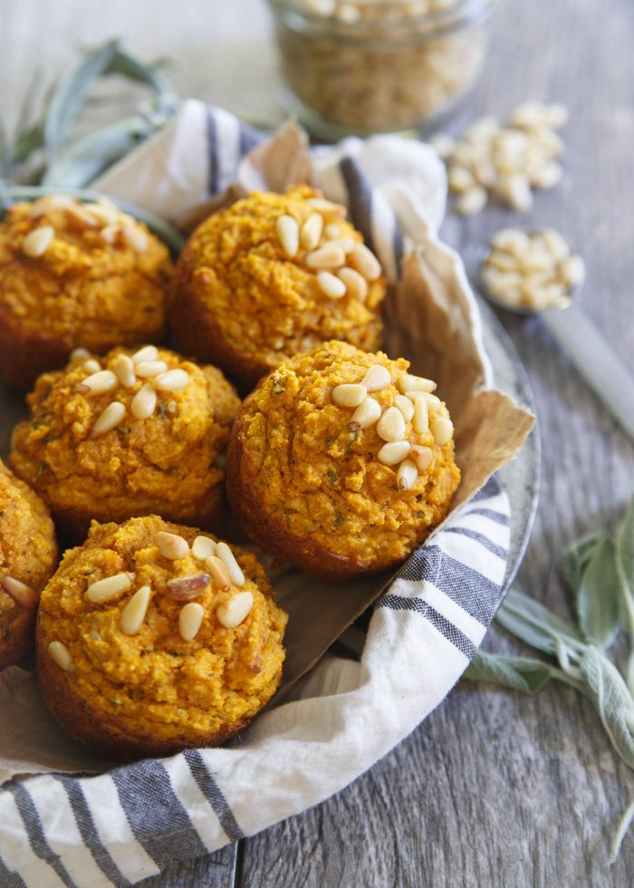 Paleo toasted pine nut herb pumpkin muffins are a savory side perfect for serving with your fall soup, stew or chili. Maybe even replace the Thanksgiving biscuits this year with a basket of these!