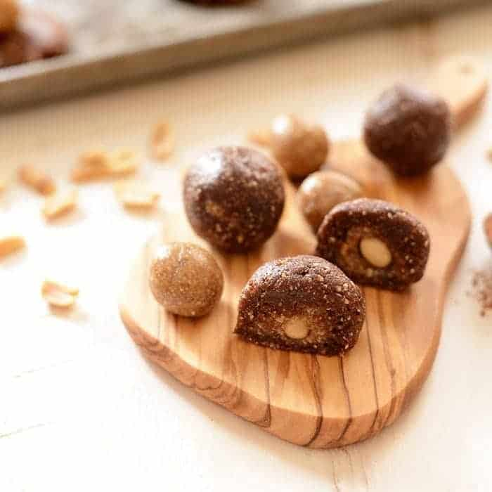 snickers energy balls on a cutting board