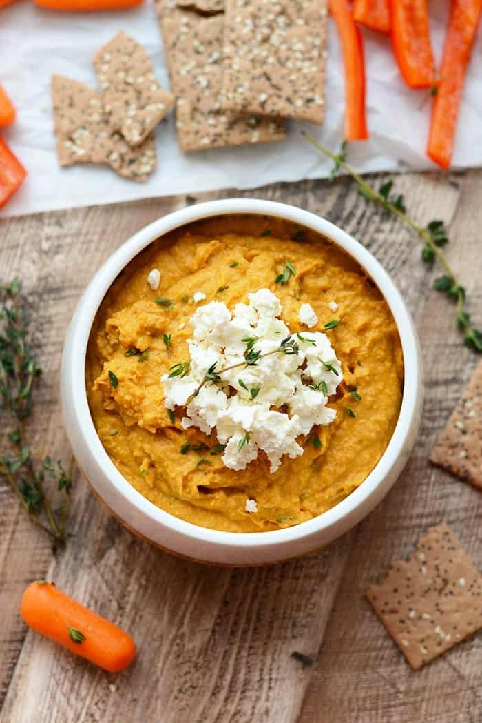 sweet potato hummus with goat cheese in white bowl