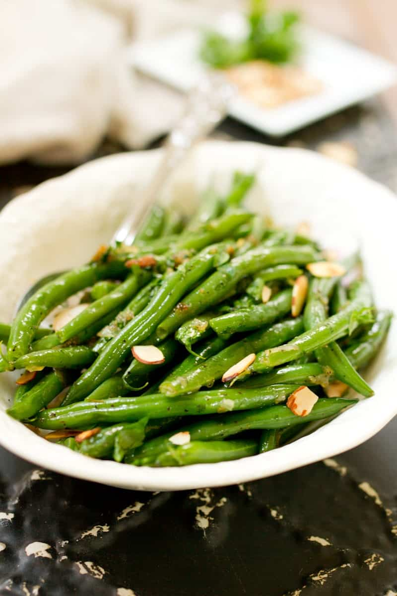 Green beans tossed with caramelized shallots, toasted almonds and fresh parsley.