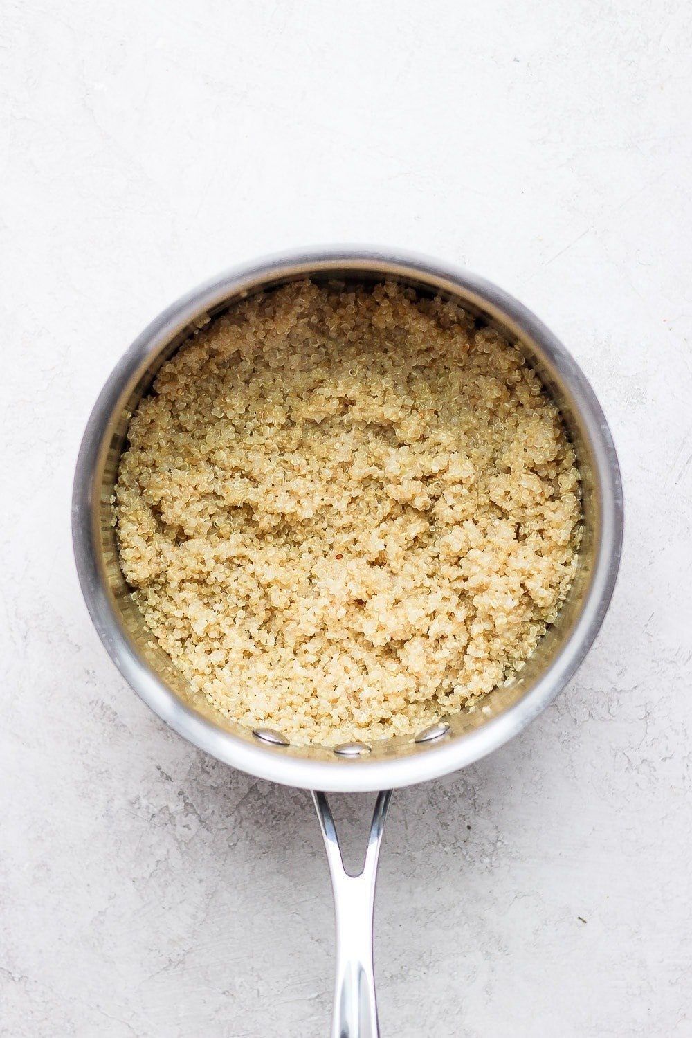 Cooked quinoa in a saucepan