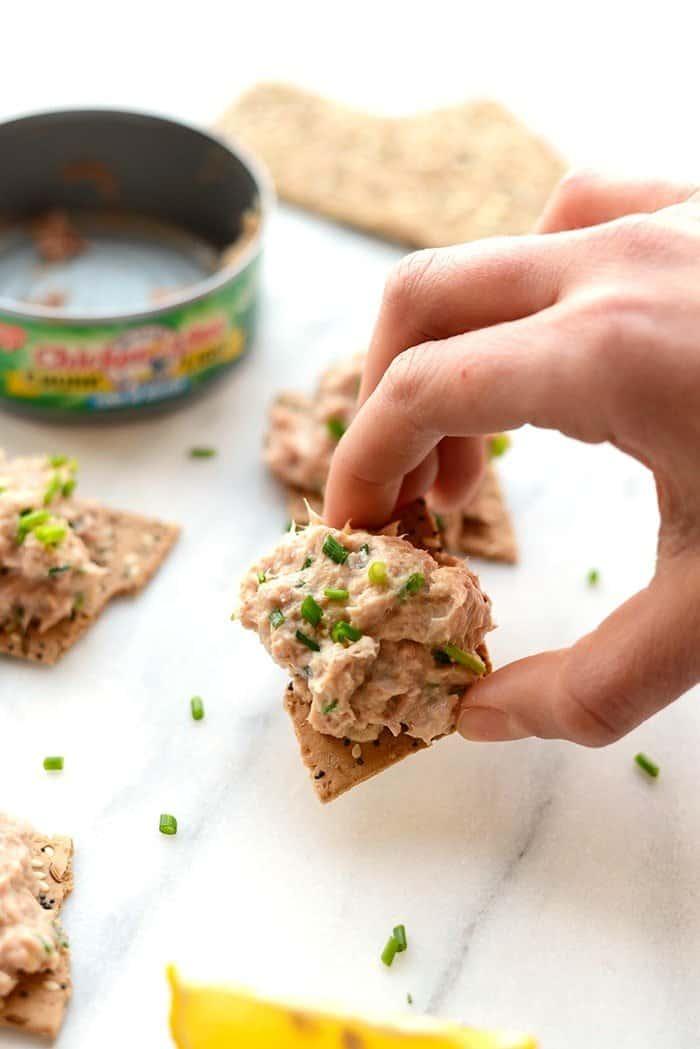 Healthy Tuna salad made with greek yogurt on several crackers
