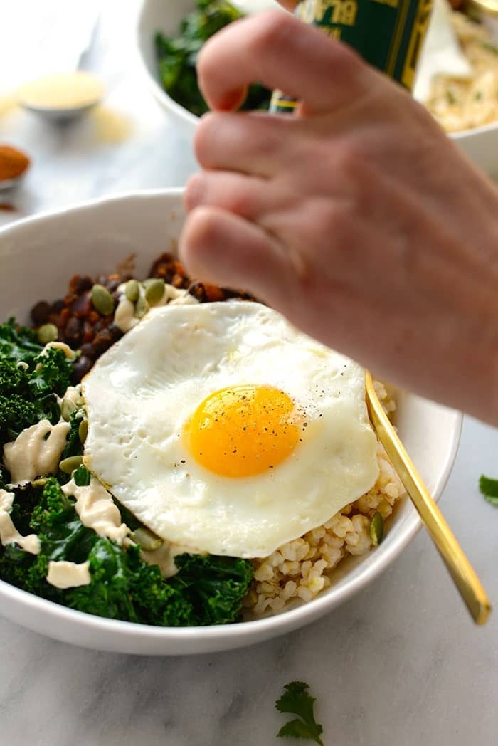 Make your breakfast a savory one and prep these delicious black bean breakfast bowls for the week! They're made with black beans, sautéed kale, brown rice, an egg, and all the fixins!