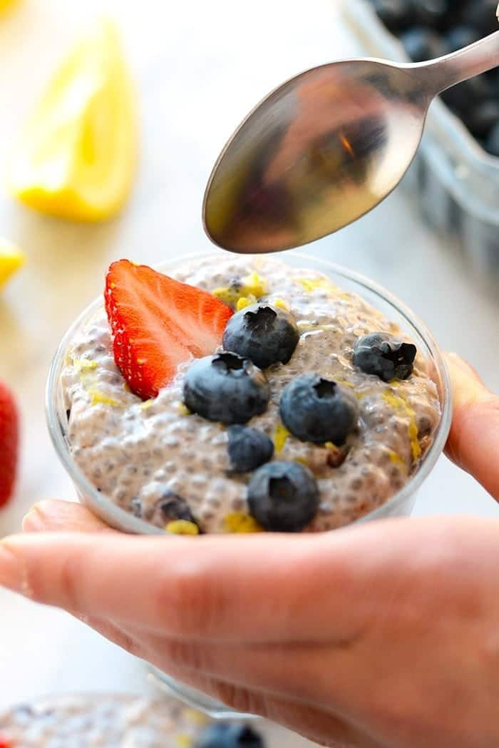 A spoon dipping into chia seed pudding
