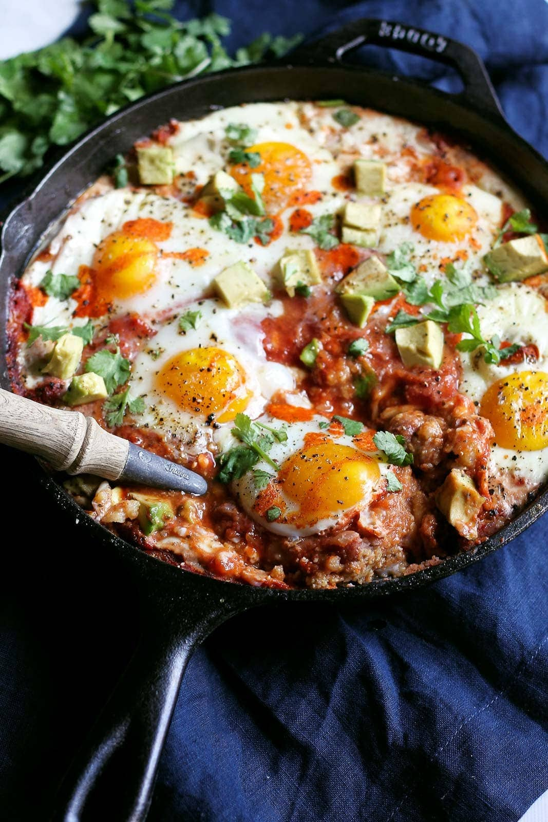 Layer upon layer of breakfast goodness! Baked polenta topped with creamy refried beans, chunky tomato salsa, cheese and eggs. Made in one skillet! Healthy, filling and over 14g protein per serving.