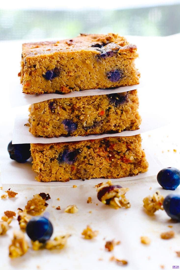 Blueberry Carrot Cake Bars are a healthy breakfast bar recipe made in less than 35 minutes! Fresh blueberry, granola, carrot, and spices! Made with gluten free ingredients, natural sugars, and a little extra protein boost.