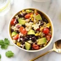 black bean couscous salad in white bowl