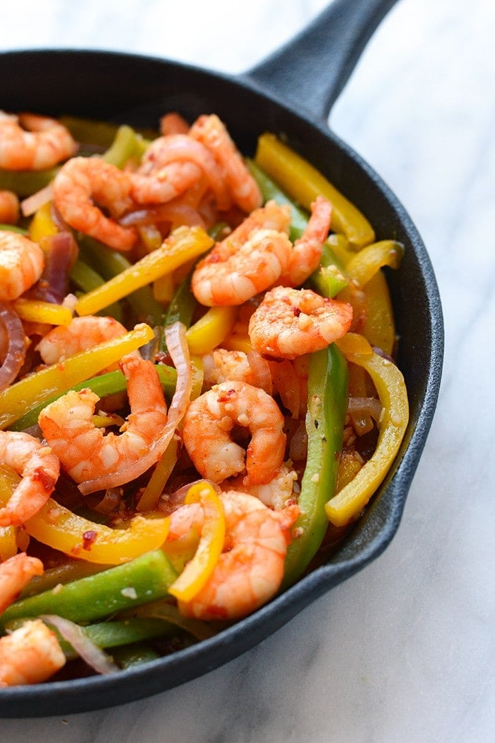 kung pao shrimp with peppers in pan