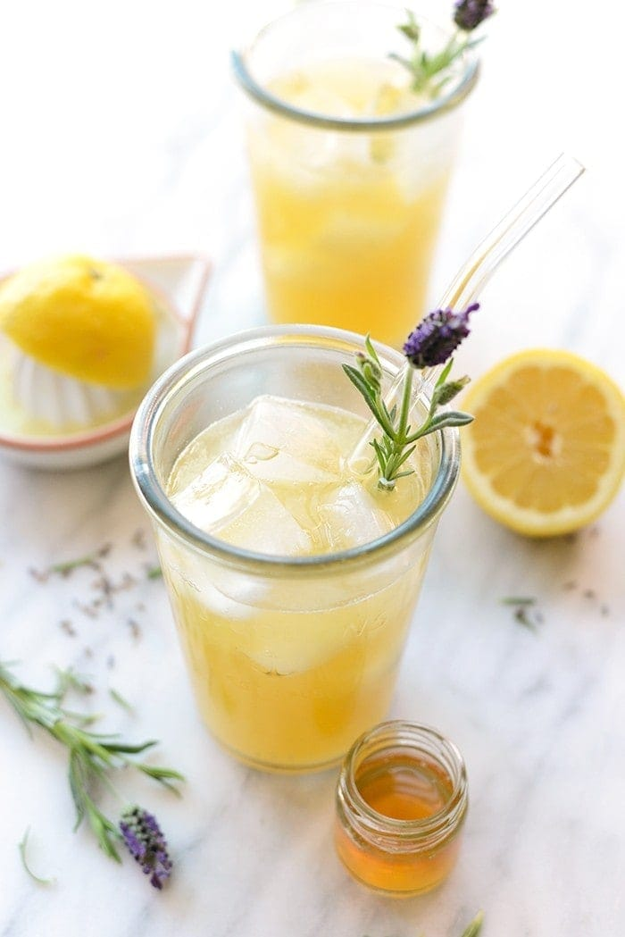 Honey Lavender Lemonade with dried lavender and small jar of honey