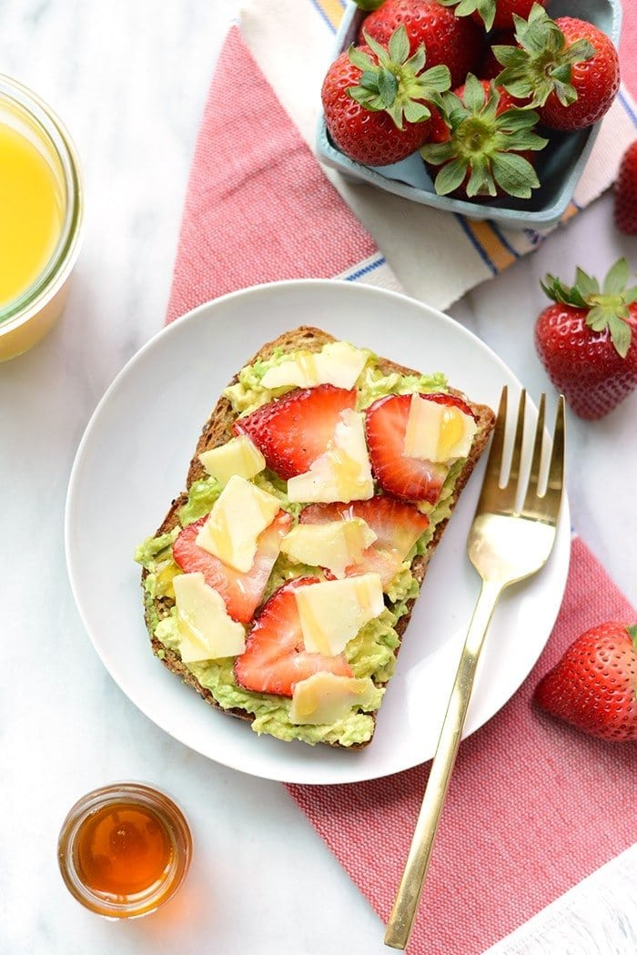 Jazz up your toast with some fresh fruit and cheese for an epic breakfast of Strawberry, Avocado, and White Cheddar Toast!