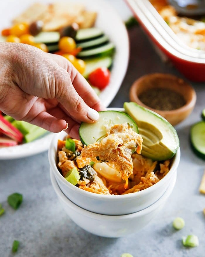 This lightened up Buffalo Chicken Dip is packed with veggies and loaded with flavor. It is the perfect cleaned up version of your favorite hearty appetizer, that can also be devoured as a main dish, too!