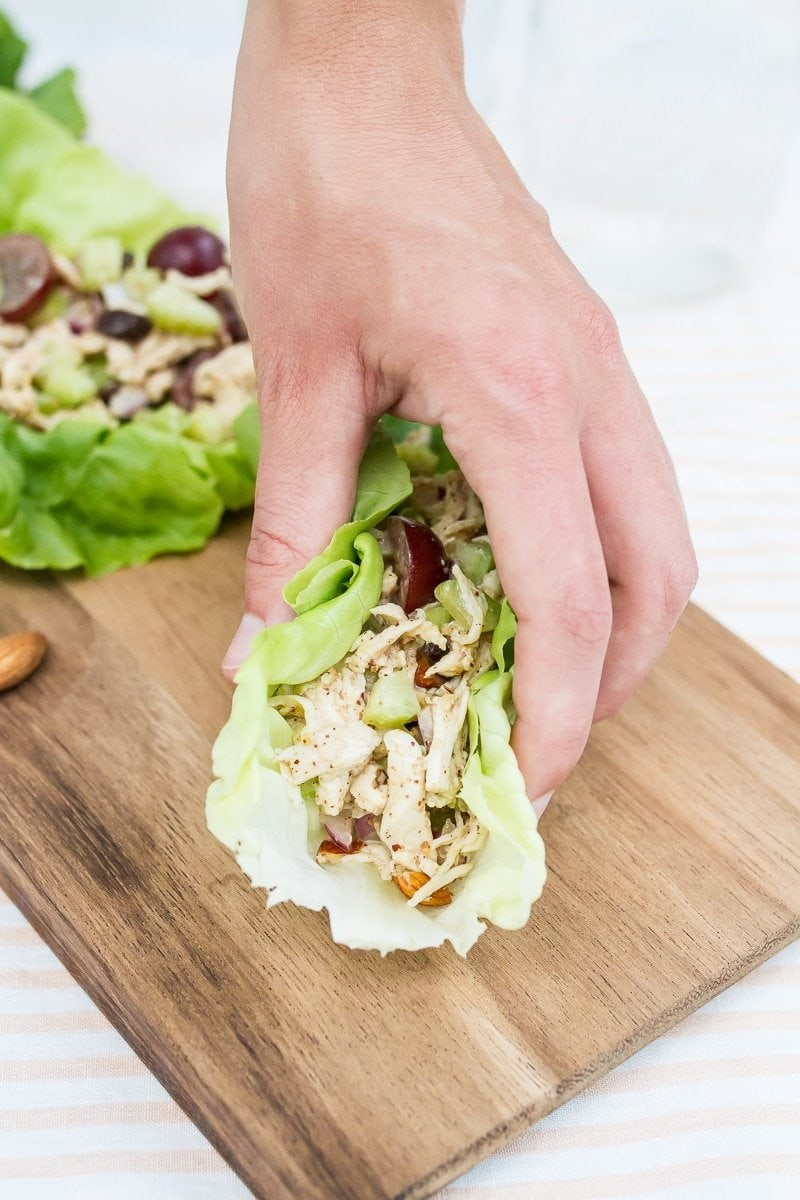 This almond butter chicken salad skips the mayo and instead uses an almond butter and apple cider vinegar dressing! Studded with raisins, fresh grapes and chopped almonds, this chicken salad is perfect for serving in lettuce wraps or on your favorite sandwich bread.